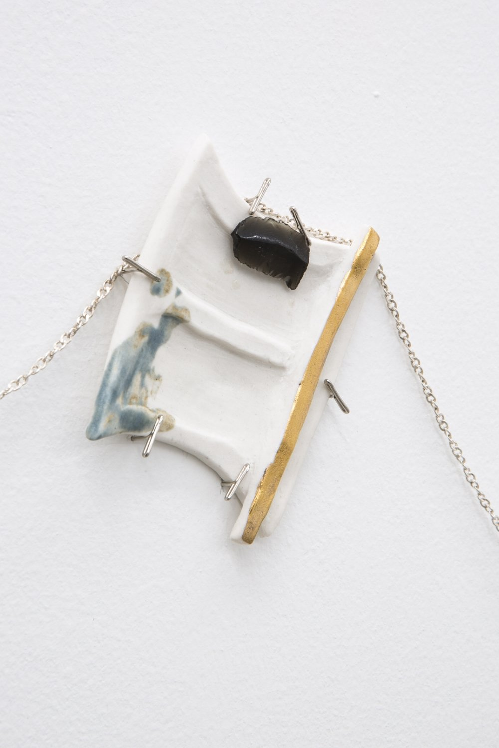 Detail view,  La Arquitectura del Mar 1 , 2018, porcelain, enamel, gold, obsidian, snake skin, goat leather, and silver chain, 80 x 90 cm