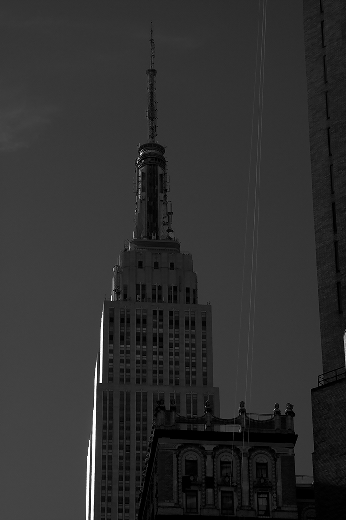 NYC, 2012  After running up town and across town from the Marc Jacobs show I stopped to take this shot of the sun setting on the side of the Empire State Building. I remember being super stressed because I couldn't find a cab after the show which meant I had to literally run to Lincoln Center. This kind of made up for it.