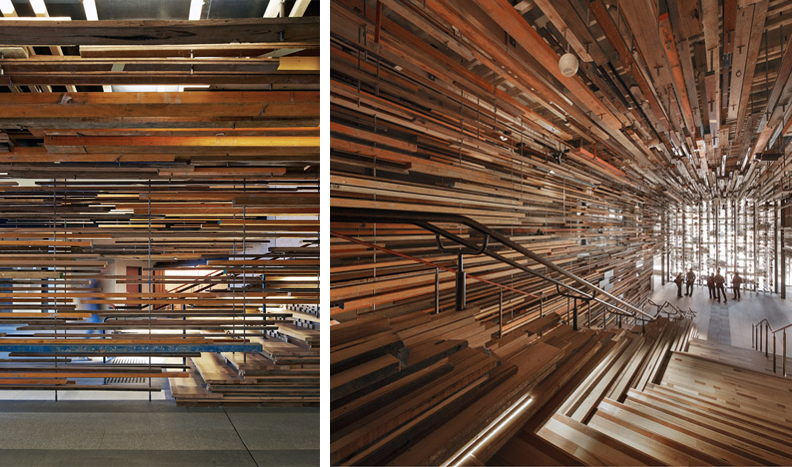 Many architects and designers were involved in designing this interior staircase at the Canberra Hotel's lobby. It features grand staircases surrounded by thousands of recycled wood panels. Each staircase step is made up of laminated timber that's camouflaged against wooden strips fixed to the ceiling, floor and walls.