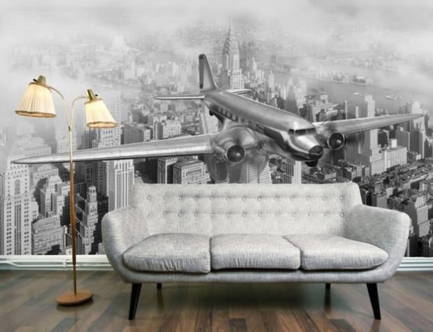 The intricate detail of this hand-illustrated mural is striking and pairing it with simple furniture creates a classy feel to the space. (Via – DC-3 Over NYC)