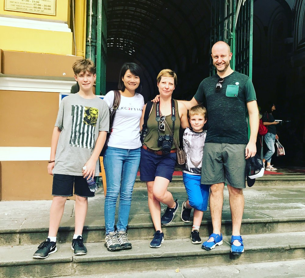 Rebecca, Greg and their children from England. Saigon Post Office.