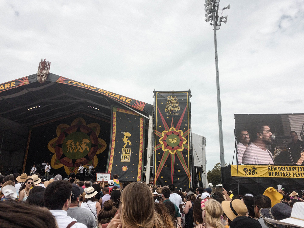 If you've ever held the belief that travel is expensive or solo travel is dangerous and scary - but have secretly wanted to do both - this post is for you!  My solo trip to New Orleans was the Abundant Result of flipping the script on those limiting beliefs! [Juanes at Jazz Fest in New Orleans]