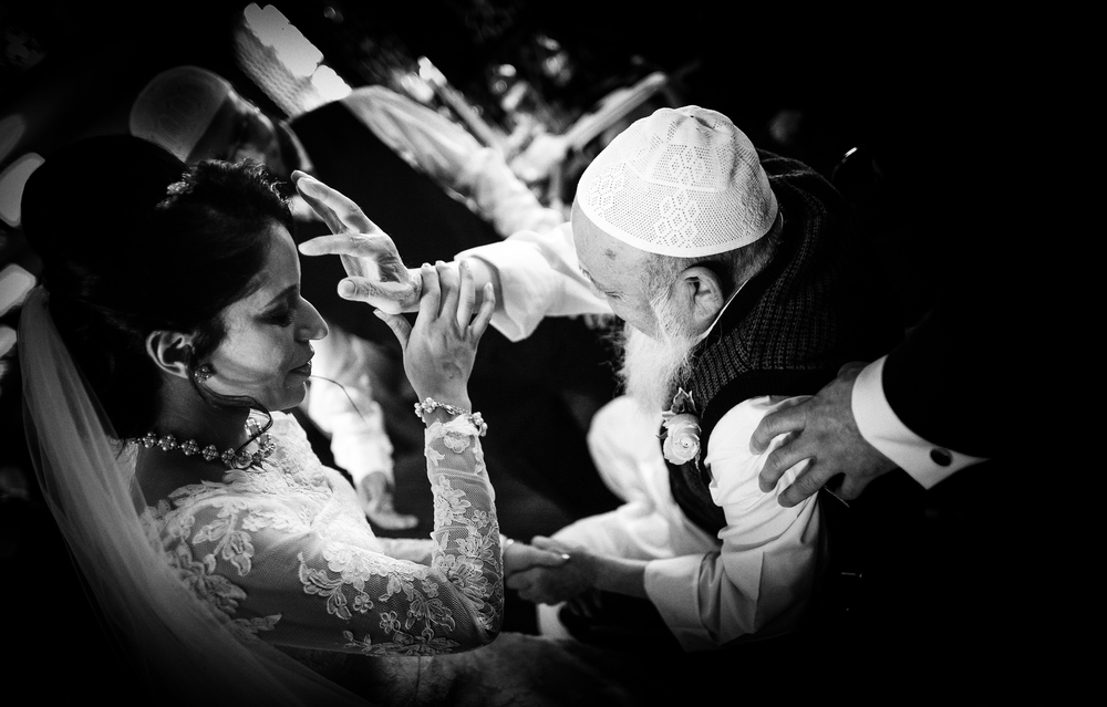 pure documentary wedding photography - Muslim bride gets a blessing from a family member after a Muslim wedding ceremony