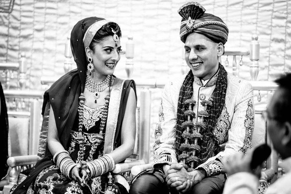 Natural and unposed hindu wedding photograph of a happy bride and groom