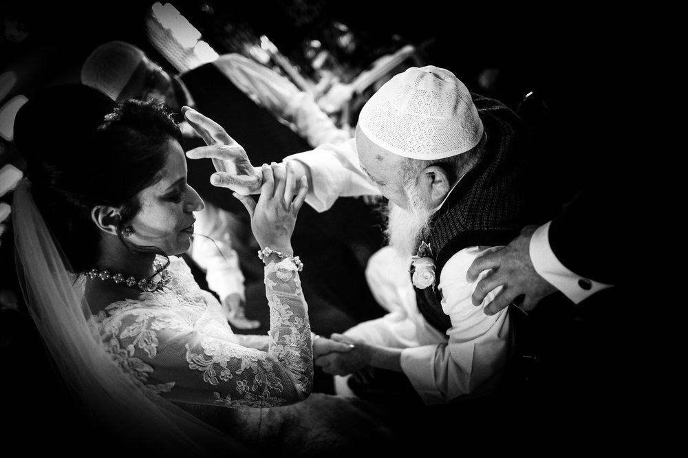 muslim bride gets a blessing - unposed wedding picture