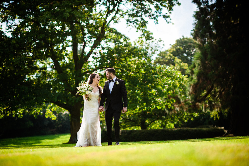 bride and groom walking outside of Kilworth House