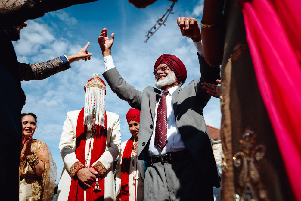 welcoming the groom - Sikh wedding ceremony