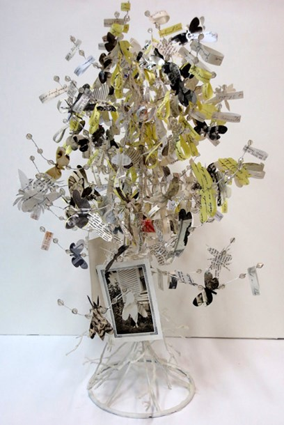 "Swarm  24"" high, mixed media: letters, photos, found beaded tree, 2014"