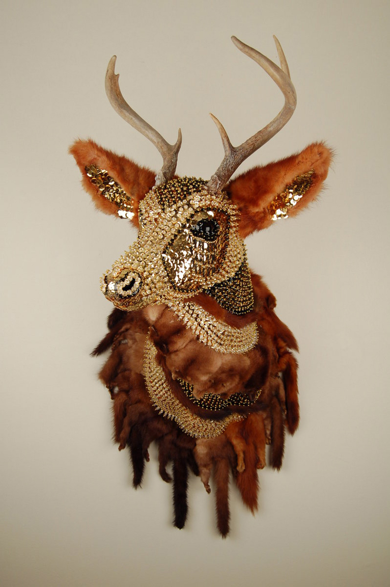 "Ring of Minks  34"" x 21"" x 14"", polyurethane foam, antlers, individual sequins, mink, beads, and pins, 2016"