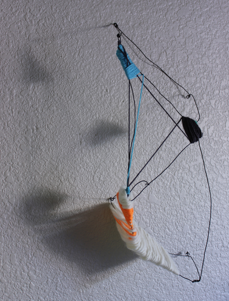 "past tense  2' x 1' x 4"", rebar tie-off wire, yarn, shadow and light, 2015"