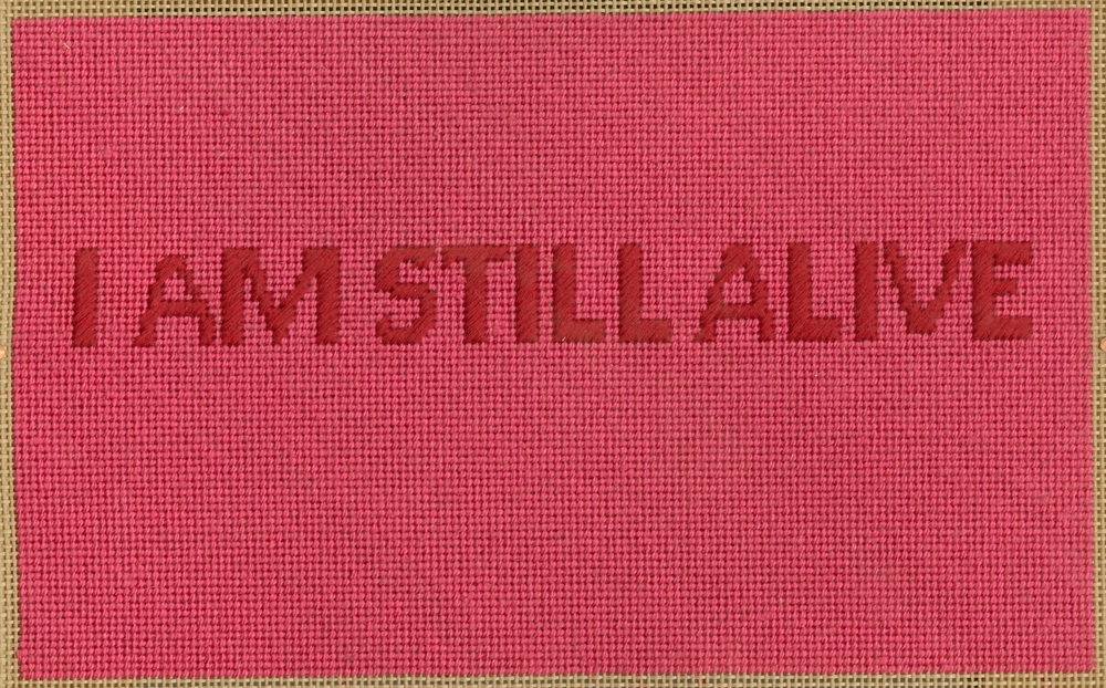 "On Kawara in Petit Point  11"" x 12"", silk floss on canvas, 2015"
