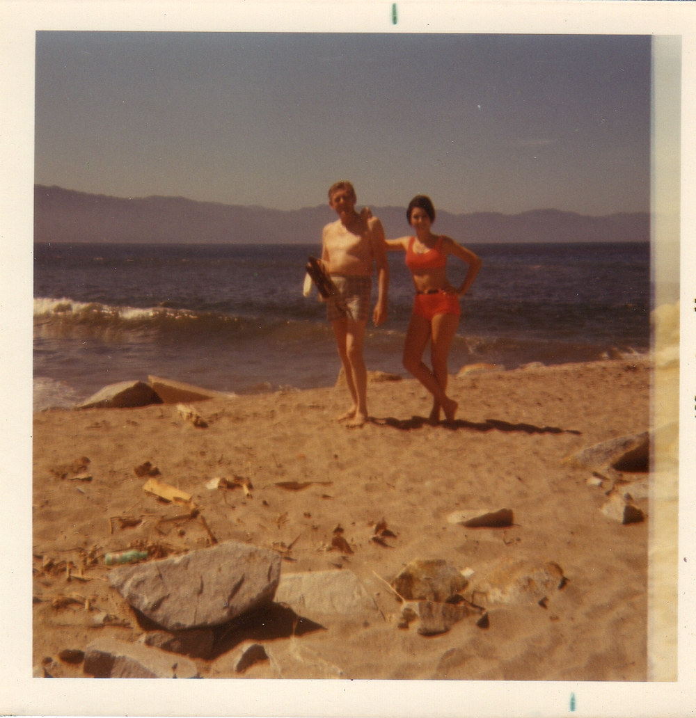 My dad and me in my one piece swim suit that my mom cut in half. 1970