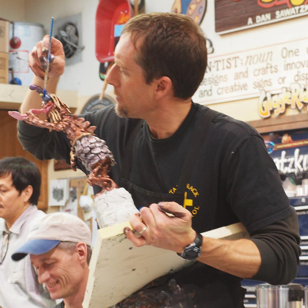 A workshop participant painting