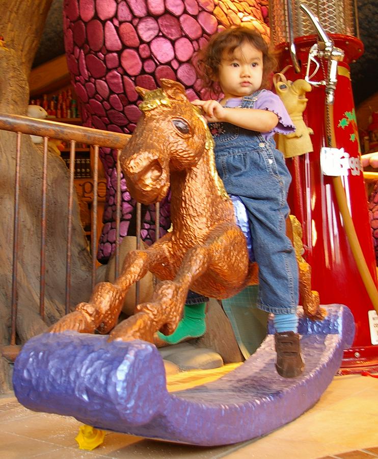 phoebe on rocking horse.png