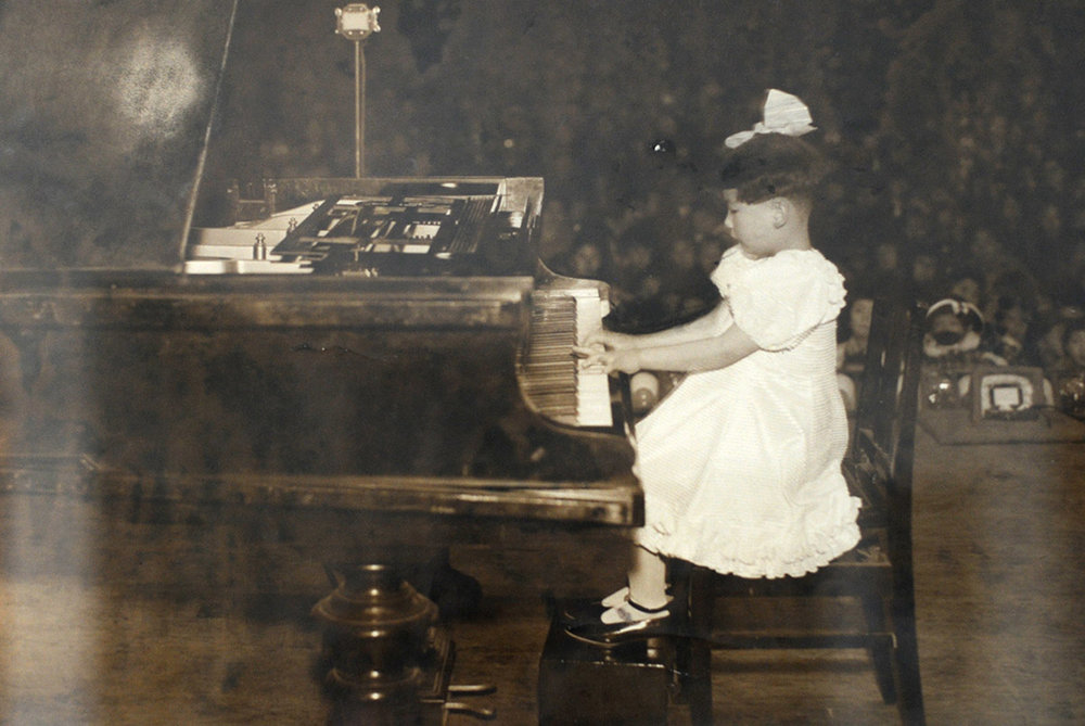 Eight-year-old piano prodigy Michi Hirata North makes her debut in 1940 at the Shin Philharmonic Orchestra (currently NHK Symphony Orchestra) in Tokyo.