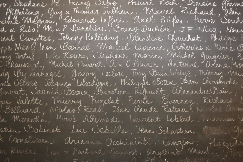 Le Chateaubriand, Blackboard where names of friends and winemakers are displayed.