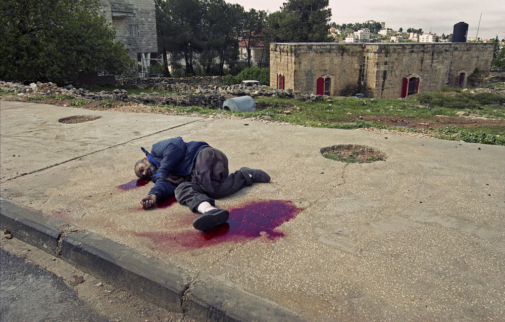 Man shot dead outside of the Mukhata, presidential Compound of Palestinian leader Yasser Arafat, during IDF's incursion in Ramallah, March 2002.