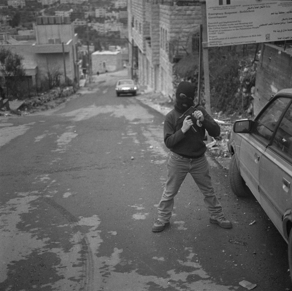 Palestinian Kid posing with his Toy Gun, Bethlehem, 2002.