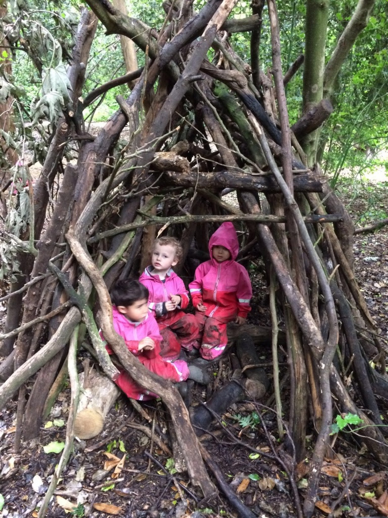 Pretending to be  'The Three Little Pigs' in the dens