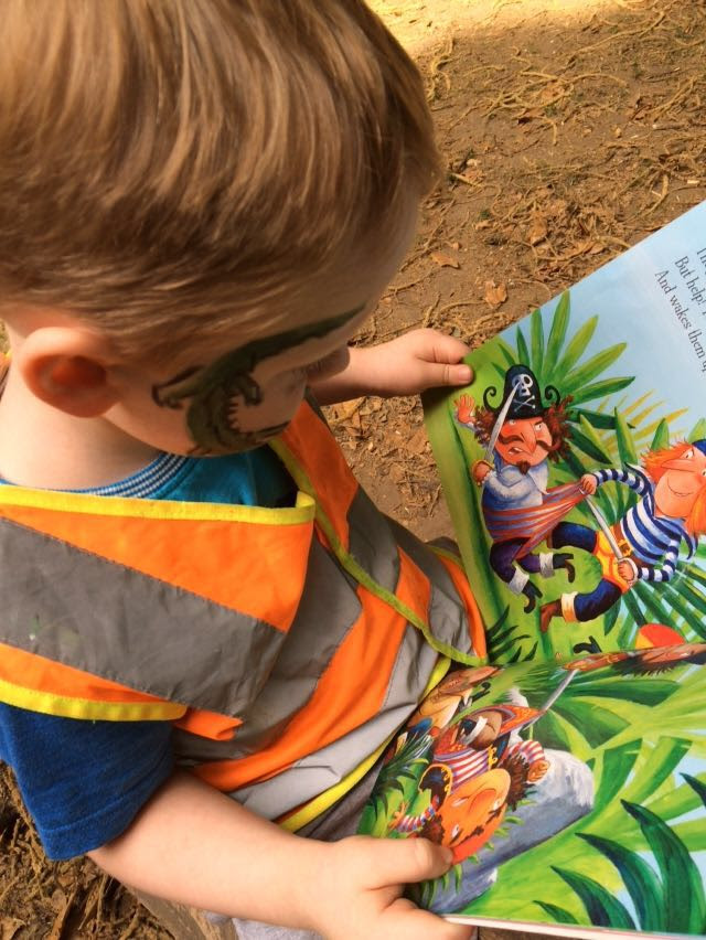 Reading about pirates in the forest