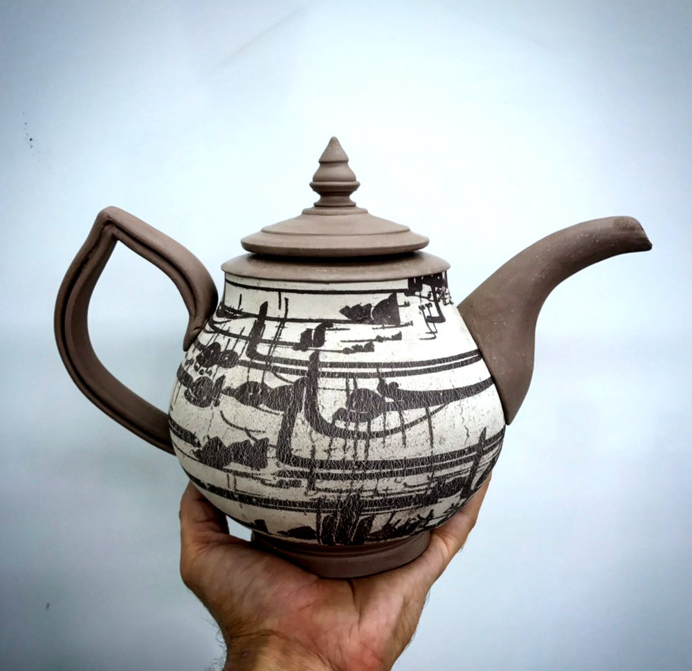 Teapot with transfer headed to the kiln