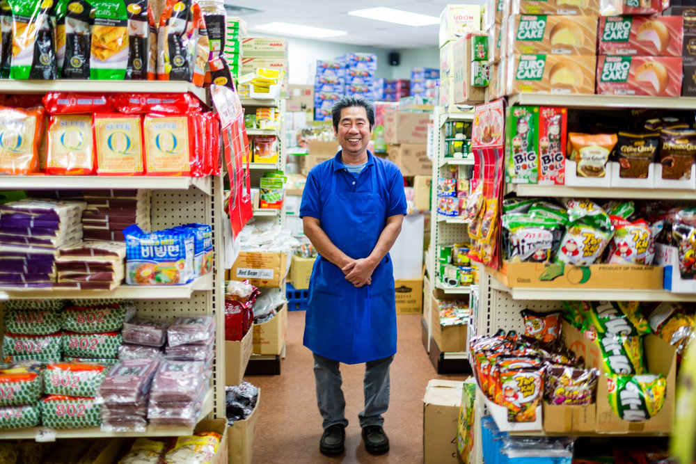 Larry Lee is the owner of Lee's Asian Market in South Asheville. Nathan Chesky: How did you find Asheville? Larry Lee: We found Asheville because we came here a long time ago, in 1982. And then we ended up moving here in 2013. The shop has been here for three years. Chesky: What countries do you have food from? Lee: It may be easier to show you. We have this whole section from China. Some of these items are from Thailand. We have stuff from Korea as well. Back here we have stuff from the Philippines. We have Indonesian noodles. Up front here we have Japanese style. All of it. Over on the first row we have Vietnamese. All Vietnamese products. We also have Indian products near the back. Chesky: Do you have a lot of restaurants in town shop here for their kitchens? Lee:  A lot of restaurants in Asheville do come here to buy their supplies. Not just retail. Probably more retail. Chesky: What are the most popular items people come for? Lee: We sell almost everything. I cannot tell you because we sell little bits of everything all the time. Oh! Tea. People are now thinking more about herbal medicine. So you can see all the teas: detox tea, cold and flu, herbal laxative, sugar free, cholesterol tea. People believe in herbal medicine. Some people come just for tea. Chesky: I see you have a whole section of nonfood items. What all do you carry here? Lee: We have some stuff for Buddhist people to pray to — incense from Vietnam and Thailand, some from China. We have some stuff for winter. If electricity is down we have gas, for a stove for cooking indoors. We have kitchen supplies. I sell a lot of knives. Sushi knife, woks, steamers for steam buns, hot pots, sake sets and tea sets. Chesky: Do you import everything here yourself? Lee: We buy through a company in California and New Jersey. I don't want to buy from Atlanta ... they mark up too much. Chesky: Why did you decide to open here? Lee: We are related a bit to Asiana, the grand buffet right here. We came to visit and talk, and we felt that people here talk about where to purchase the supplies for cooking Asian style. They did have some but not a good one. So I felt that I could (succeed) ... I have been in California and knew companies in New York. That's why I feel like maybe I could fix everyone's needs for cooking Asian style. Chesky: Are there things customers want that you maybe can't bring here to Asheville? Lee: Yes, live fish. I don't want to do. First, my room is too small. Second, I don't want people to have to kill them. (Laughs.) Chesky: How long would it take to get something if I ordered something specific? Lee:  If the company in California carries it, one week. Sometimes if the company doesn't carry it, it can take a little more. Some things we can't even find here. Sometimes customers can find that stuff online, so I don't feel the need to order it. Chesky: Is there anything you can't get here that you would want to order for yourself? Lee: Oh, yeah. The one that I want, that I cannot get, is Chinese bakery. Like Chinese baked bread with filling. Toro, custard and red bean. Chesky: How is business? Lee: Sometimes up, sometimes down. I feel that there may not be enough of an Asian population here. We cannot focus on Vietnamese or just Chinese, because there may only be like 10-20 families of Chinese or Vietnamese here. If I opened a Vietnamese store, we are not surviving. Open a Chinese-only market, we are not surviving. So we must carry a little bit of everything. Here we focus a good bit on Chinese and Thai as well. There is a Thai restaurant right next door, as well as a Vietnamese restaurant. Chesky: Have you noticed any changes in Asheville in the past few years? Lee: Yeah, I feel more people are moving here. And we see a lot of different people. We talk to them and they are on vacation of some kind, or they move in from Florida, Ohio or something like that. Chesky: I talked with Christina, the owner of Korean House, and she mentioned it helped when people had moved here from a bigger city, because they were more accustomed to trying different types of Asian foods. Have you noticed this? Lee: Yes. Most people who come from big cities like Chicago, West Coast, Northern California or Oregon. Chesky: Anything else you would want people to know about coming here? Lee: We have some famous coffee: G7, Nestle Cafe and a lot of Chinese teas.