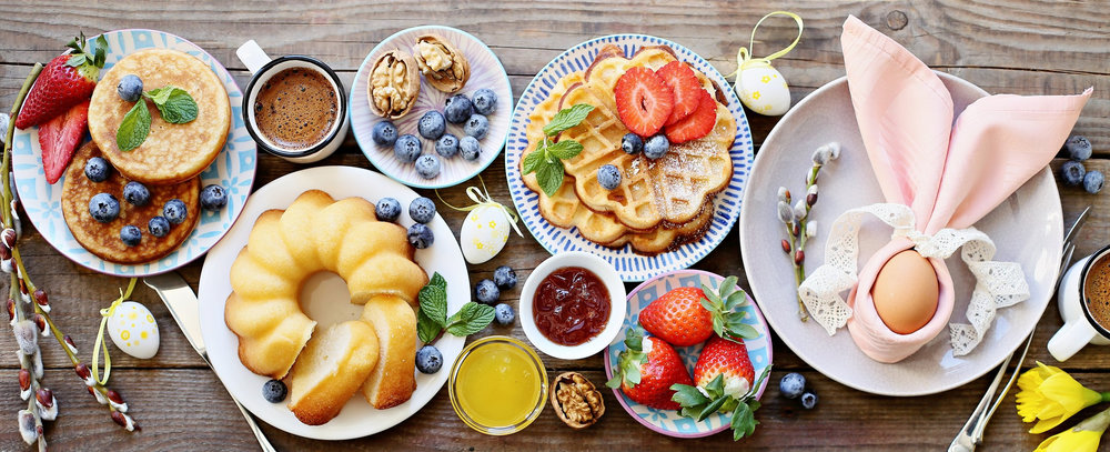 Easter+dessert+table.+Pancakes%2Cwaffles+and+bundt+cake+with+fresh+berries+and+various+of+topping.jpg