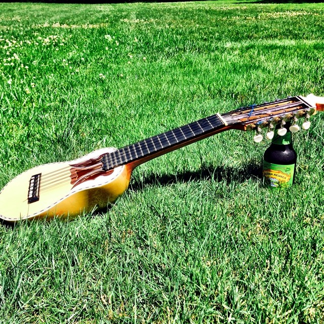 Today's writing session: a charango and beer #music #writing #beer