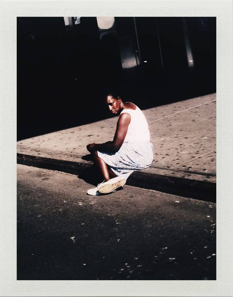 Woman sitting on sidewalk, New York from the series American Night, 2002.