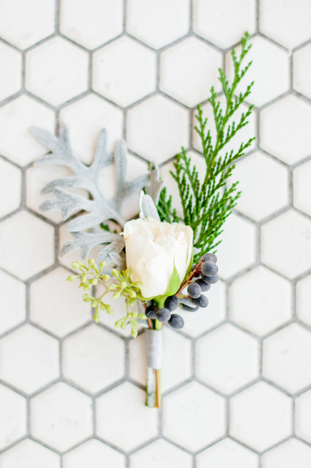 Winter white boutonniere