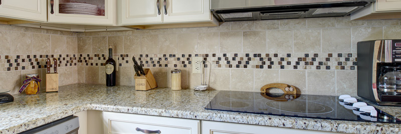 Detailed Tile Backsplash, Granite Countertops, Glass-Top Stove, Kitchen Remodel