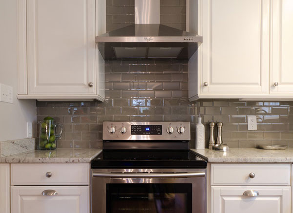 White beveled cabinets, stainless steel range hood, glass top stove, slow close drawers, subway tile backsplash, Kitchen Remodel