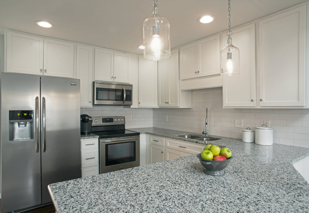 White Shaker Cabinets, Subway Tile Backsplash, Granite Countertops, Stainless Steel Kitchen Remodel