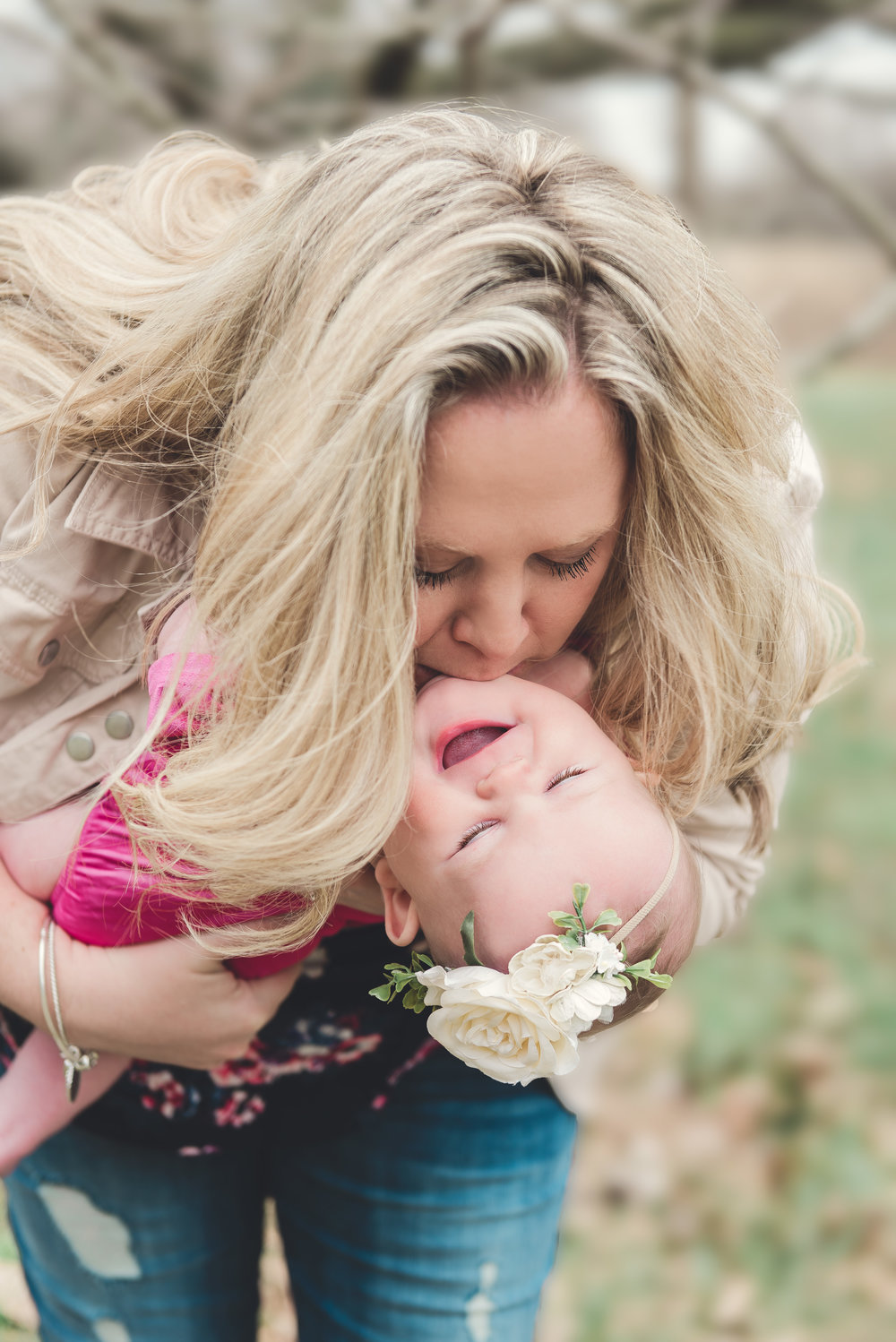 Mom kissing baby candid image