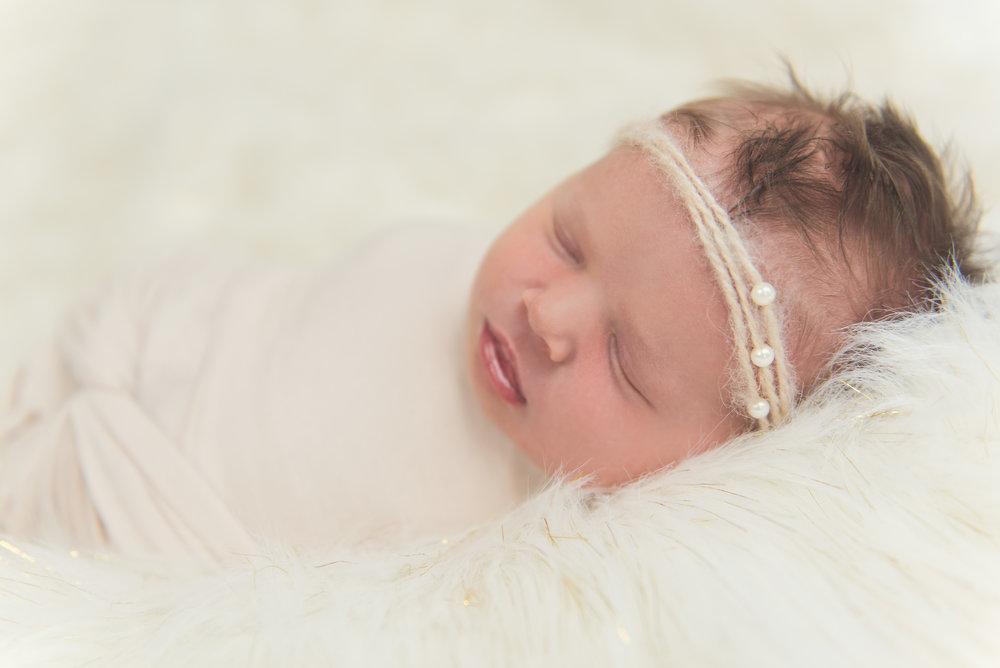 newborn baby girl close up