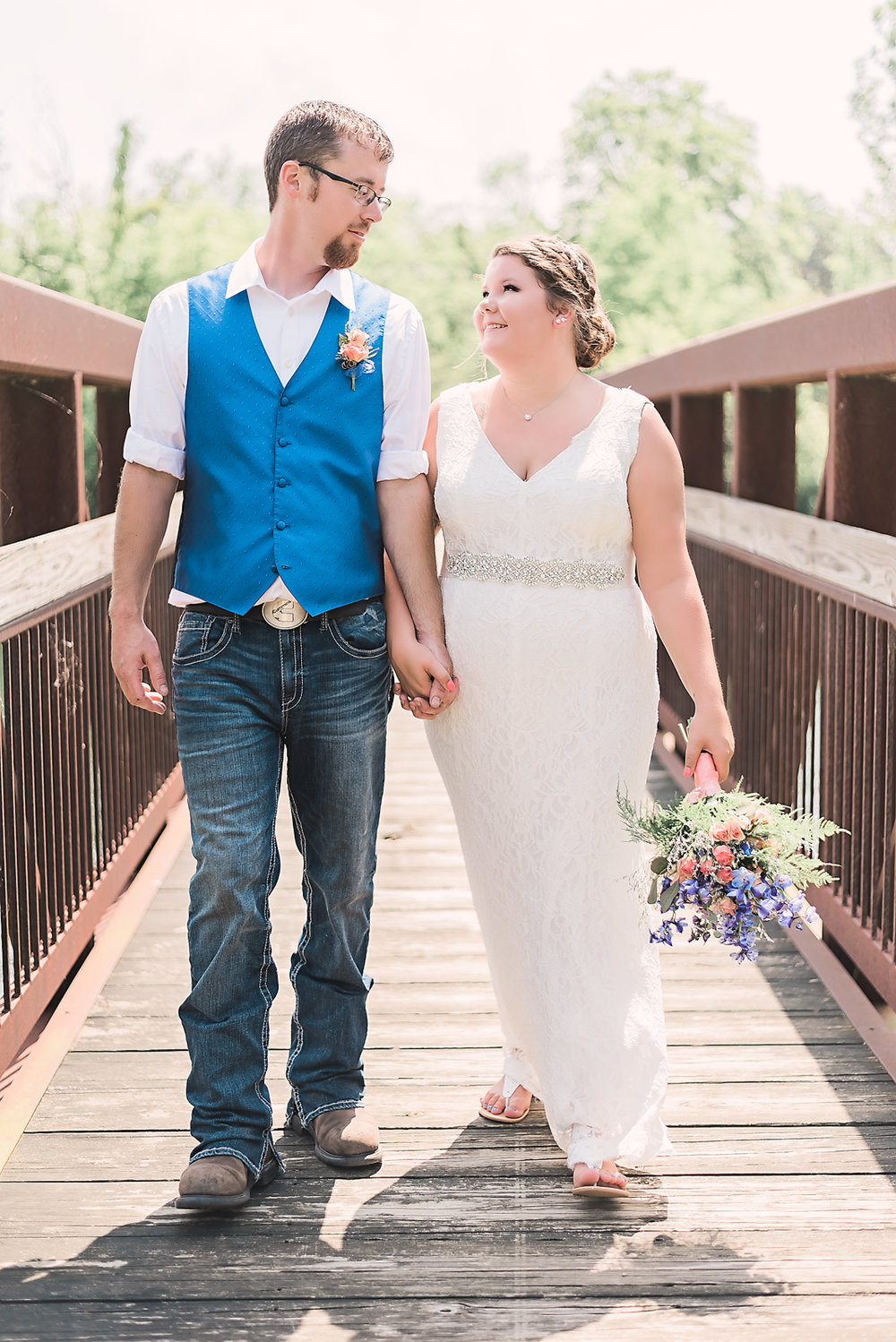 bride and groom on bridge portrait