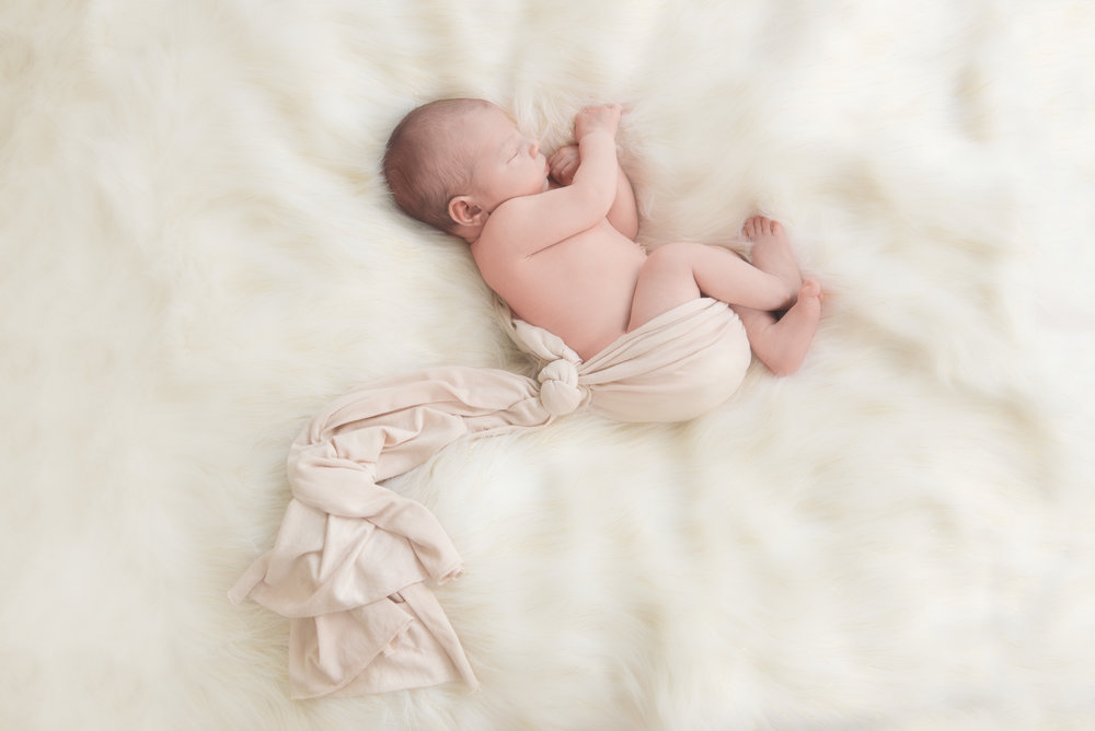 stork wrap newborn pose