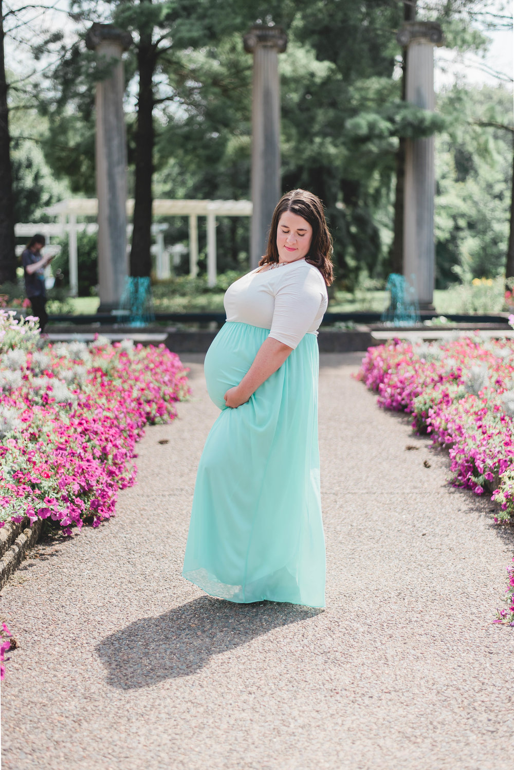 maternity photos with flowers leading lines