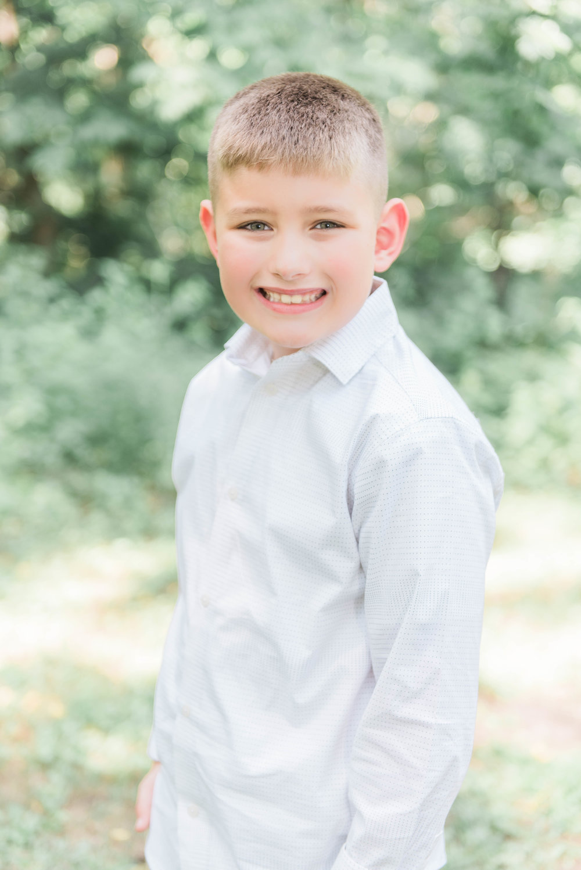 little boy hands in pocket pose outside funks grove white chapel