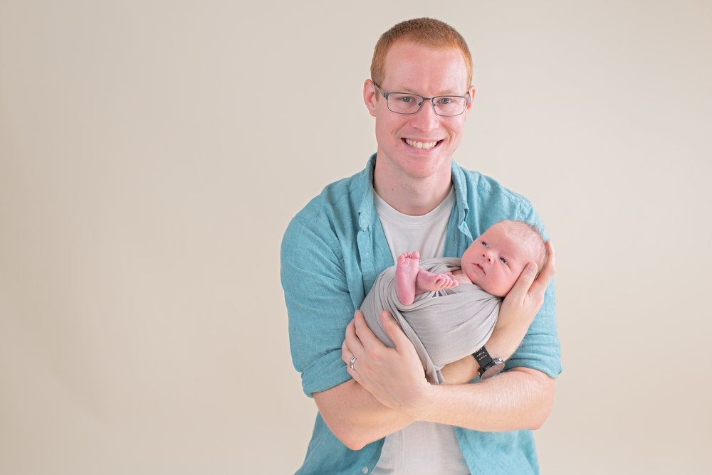 dad holding newborn pose