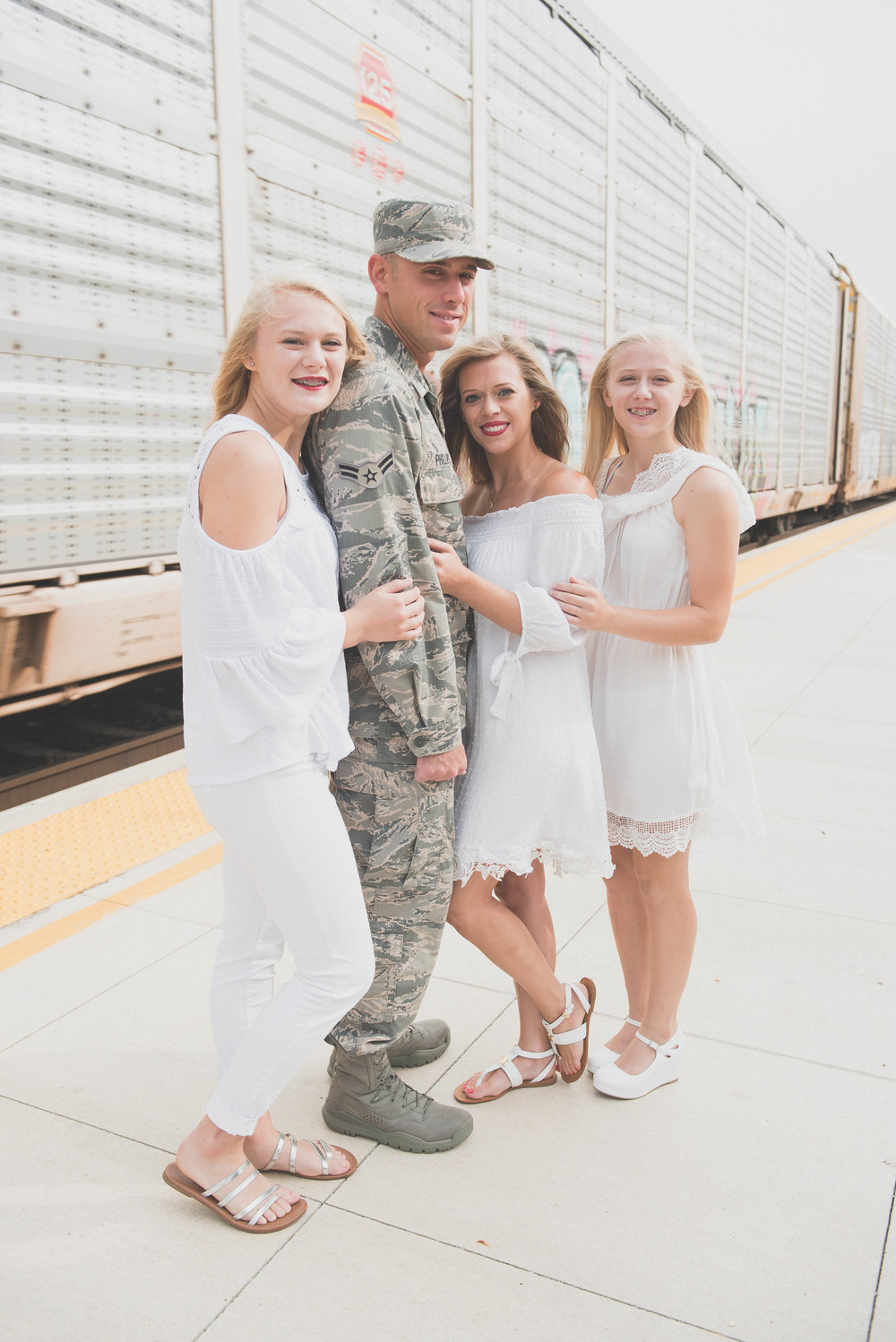 family photo in front of train