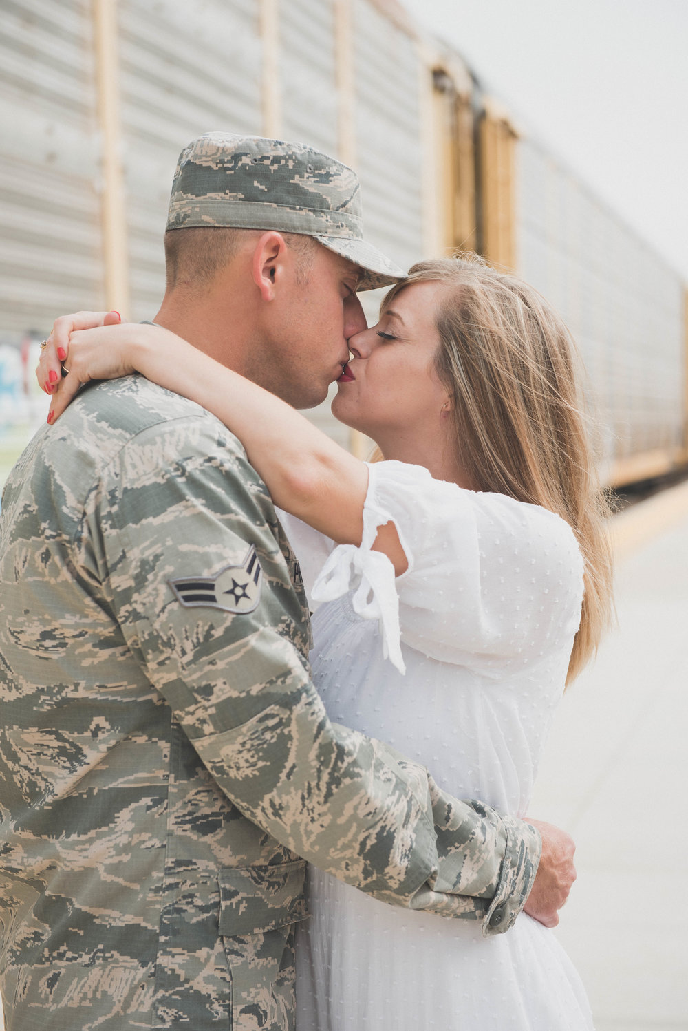 close up kiss in front of train military