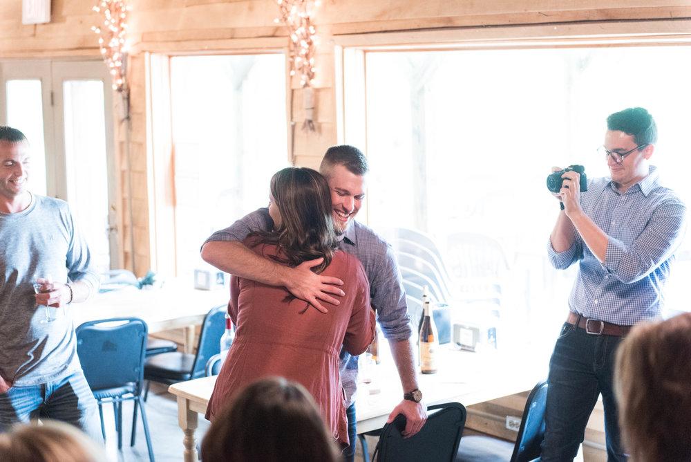 hug for engaged couple