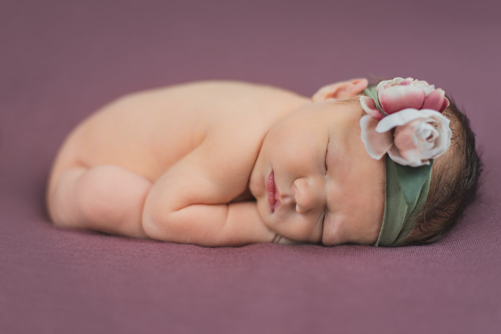 purple background baby girl