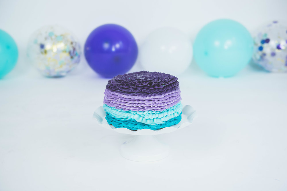 purple & turquoise smash cake with decorations