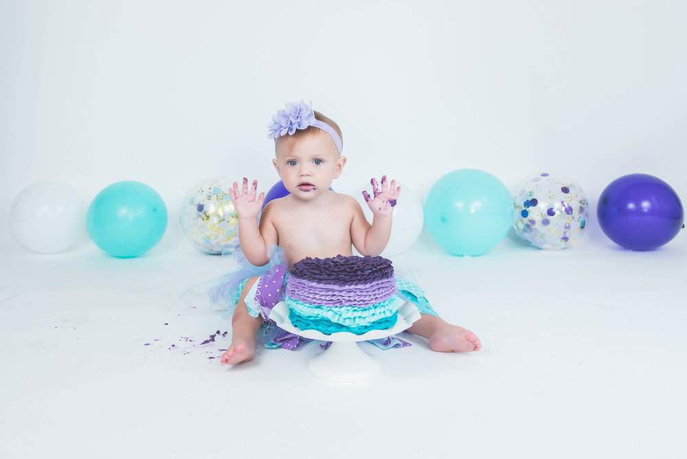 photos by ariel cake smash girl in studio purple and turquoise