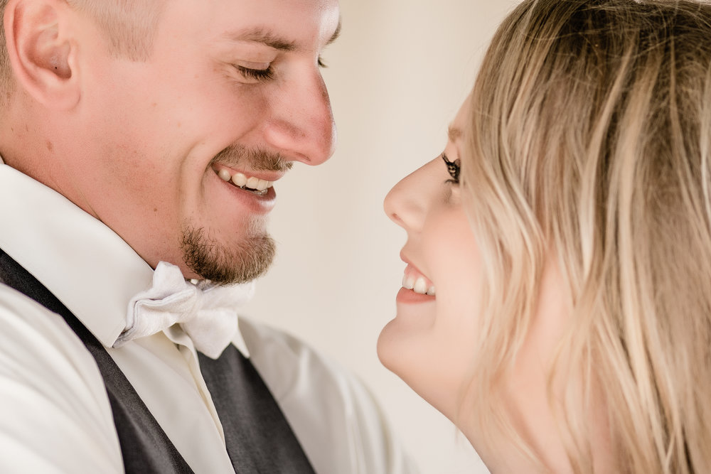 bride & groom close up laughter