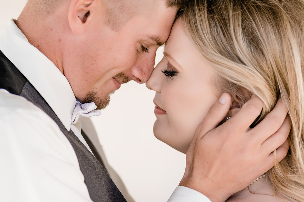 bride & groom close up with foreheads touching