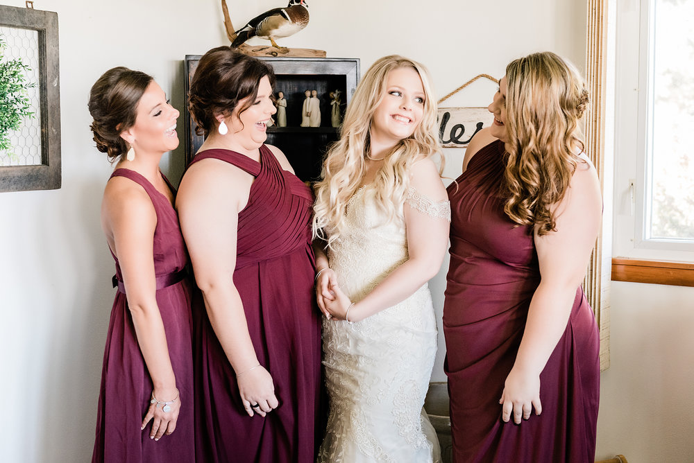 bridesmaids getting ready laughing