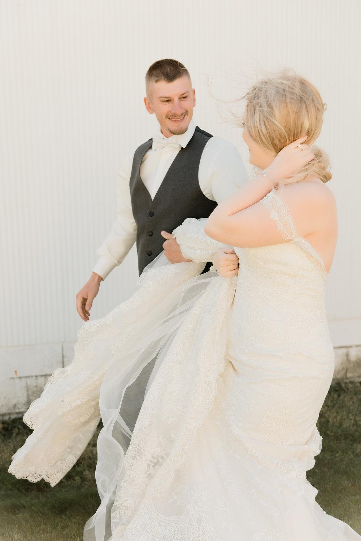 candid bride & groom walking